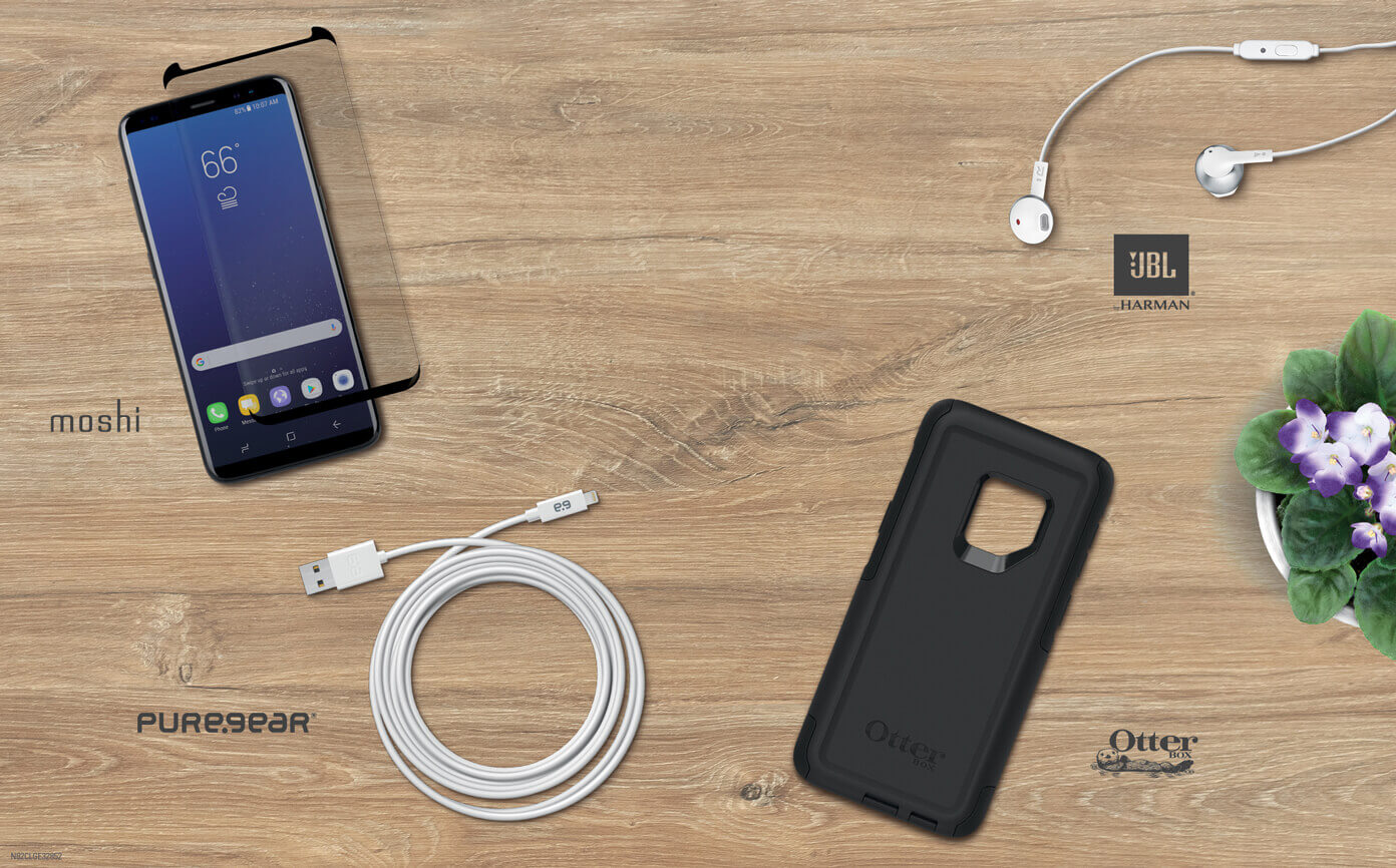 Flat lay of products: Moshi Screen Protector, PureGear Charging Cable, Otterbox Case, JBL headphones