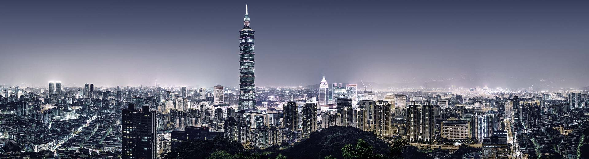 The glittering cityscape of Taipei, with innumerable skyscrapers and high-rise apartment complexes as far as the eye can see