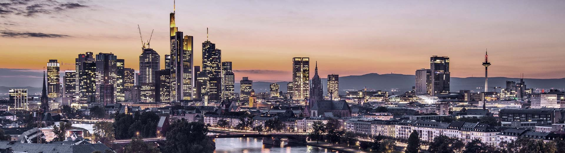 The looming skyscrapers of Frankfurt's financial district at sunset