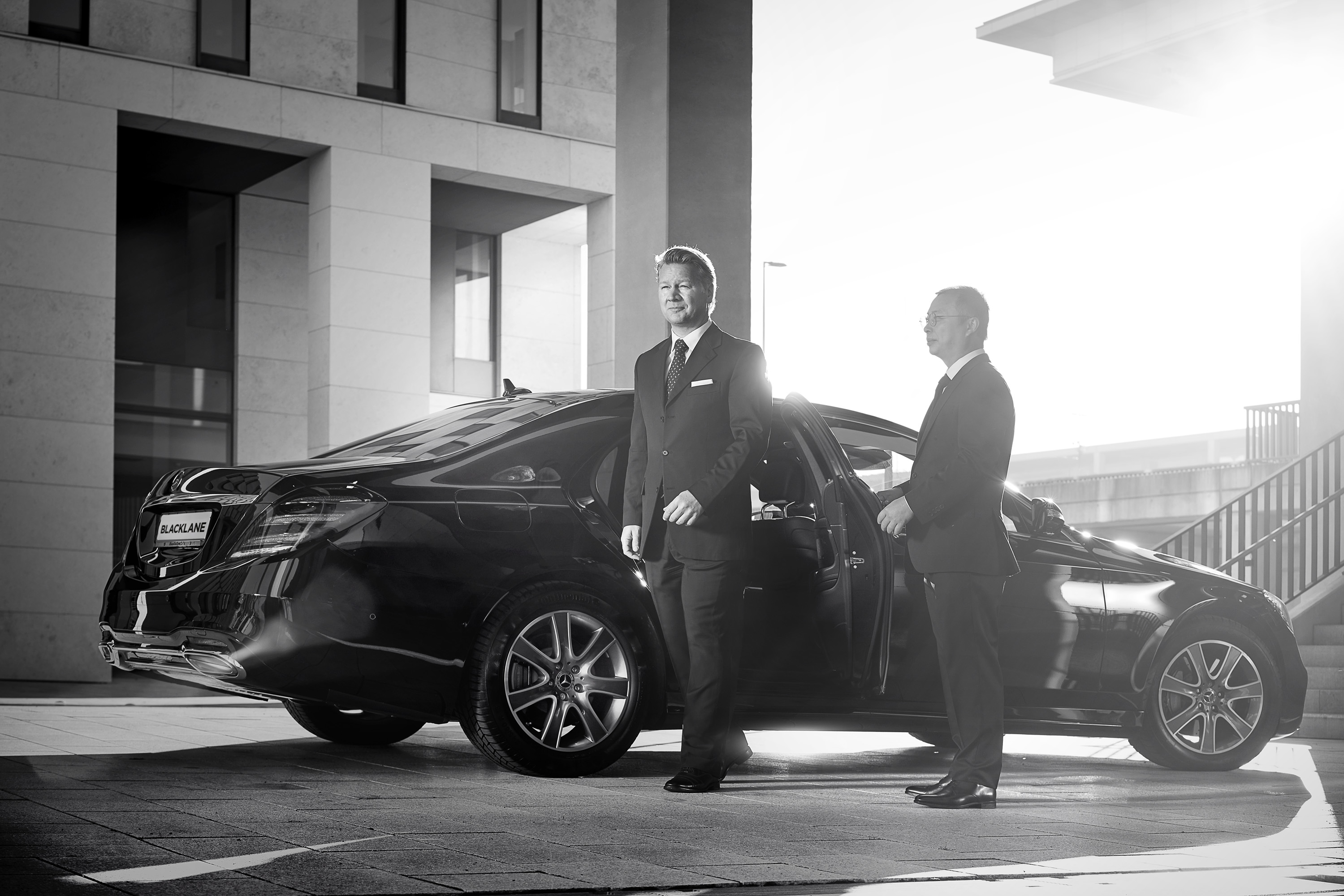 Blacklane -- Chauffeur holding door for guest