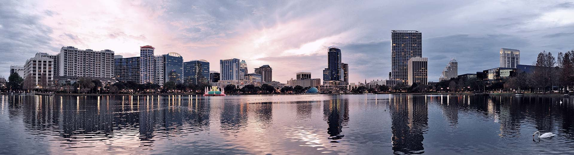 Tall square buildings of Orlando overlook the water of the Atlantic Ocean