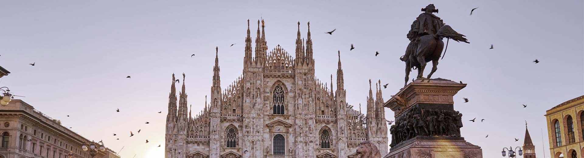 The beautiful cathedral of Milan, with the sun setting in the background
