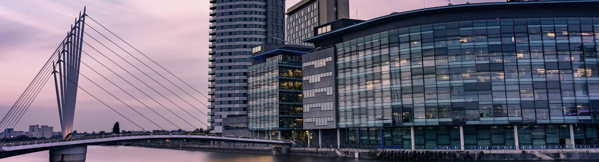 Commercial buildings and a modern bridge in Manchester