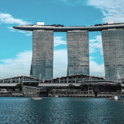 The three towers of the Marina Bay Sands Hotel stand across the bay from Downtown Singapore.