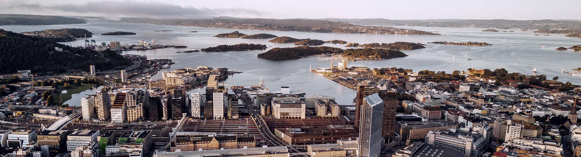 The tall buildings of Oslo overlook the coast of Norway