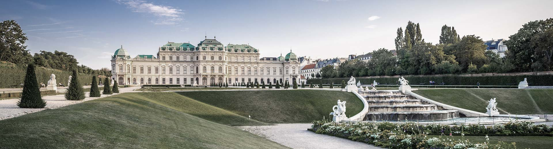 The world-famous Schönbrunn Palace lies among it's incedibly manicured lawns on a beautiful, clear day
