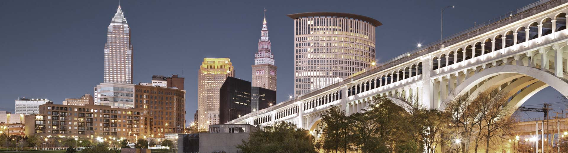 The distinctive skyline of Cleveland lights up the night sky