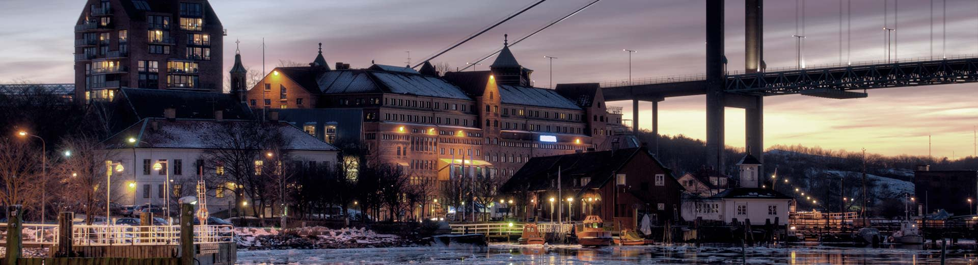 Historic buildings along the banks of Gothenburg at night