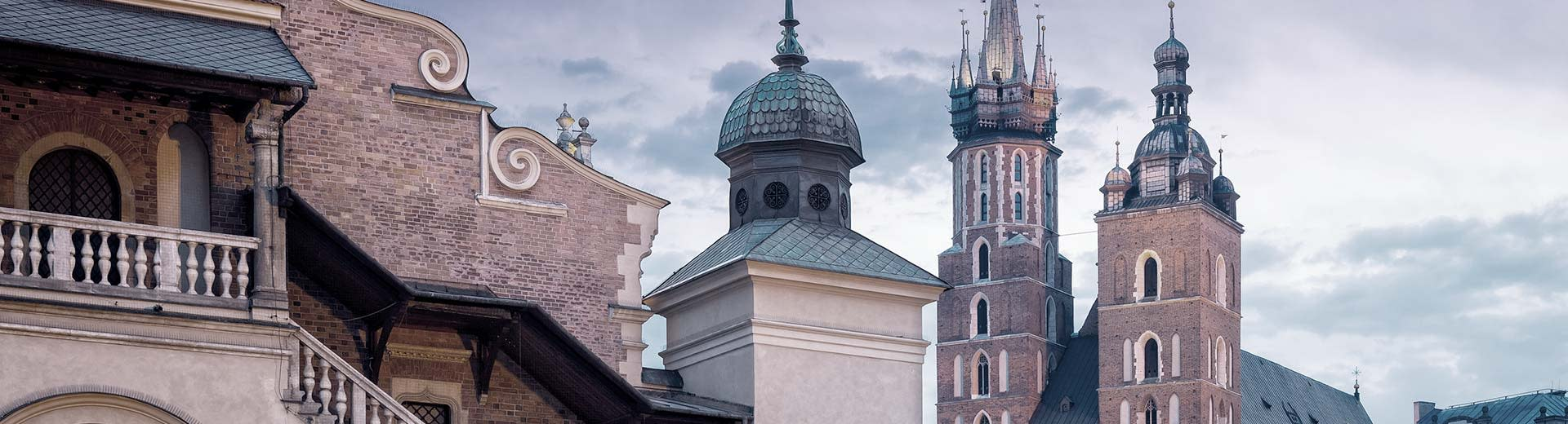 Beautiful Polish churches set against a cloudy sky in Krakow