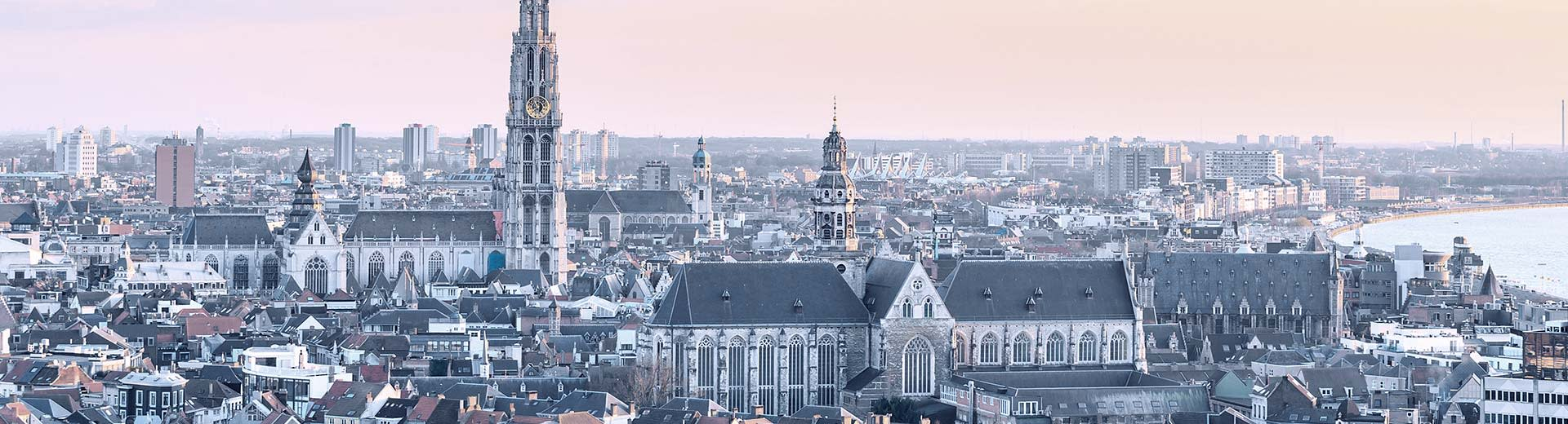Pink and orange sky with the beautiful old architecture of Antwerp city center in view
