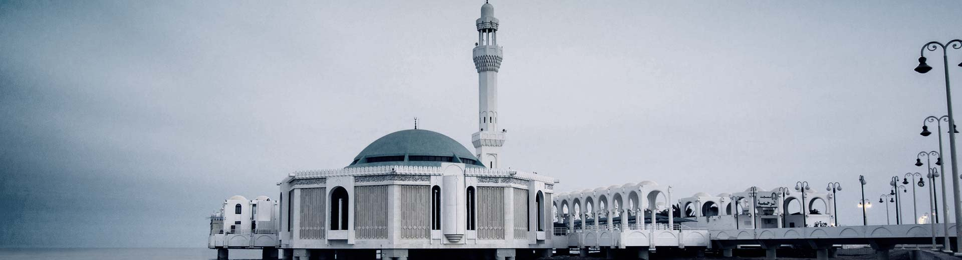 A white mosque on a rare grey day in Jeddah