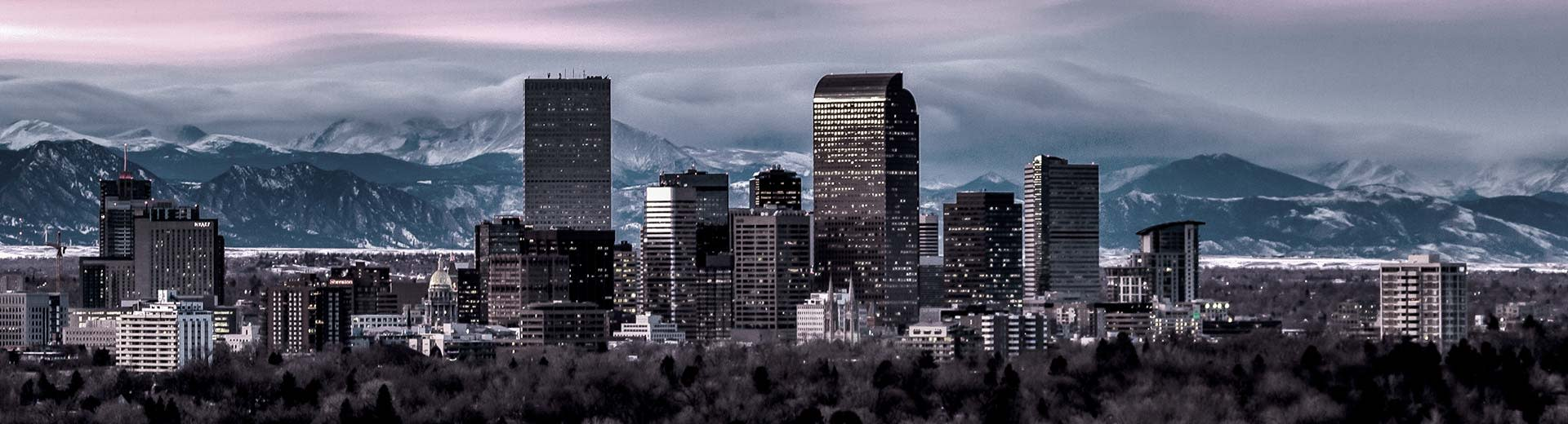 The city of Denver, with the Rocky Mountains in the background and skyscrapers to the fore