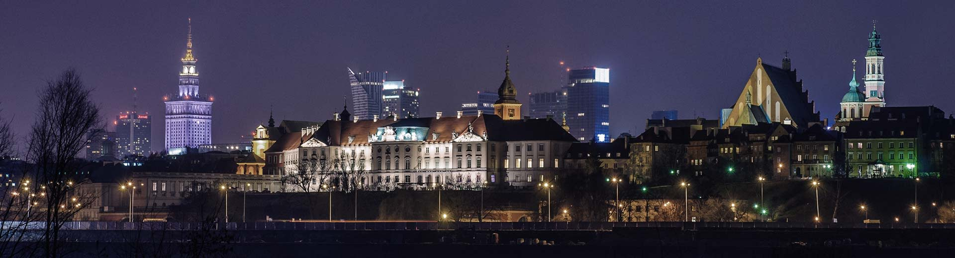 The famous Warsaw Palace of Culture and Science dominates the background, while in front are low-rise Polish apartments