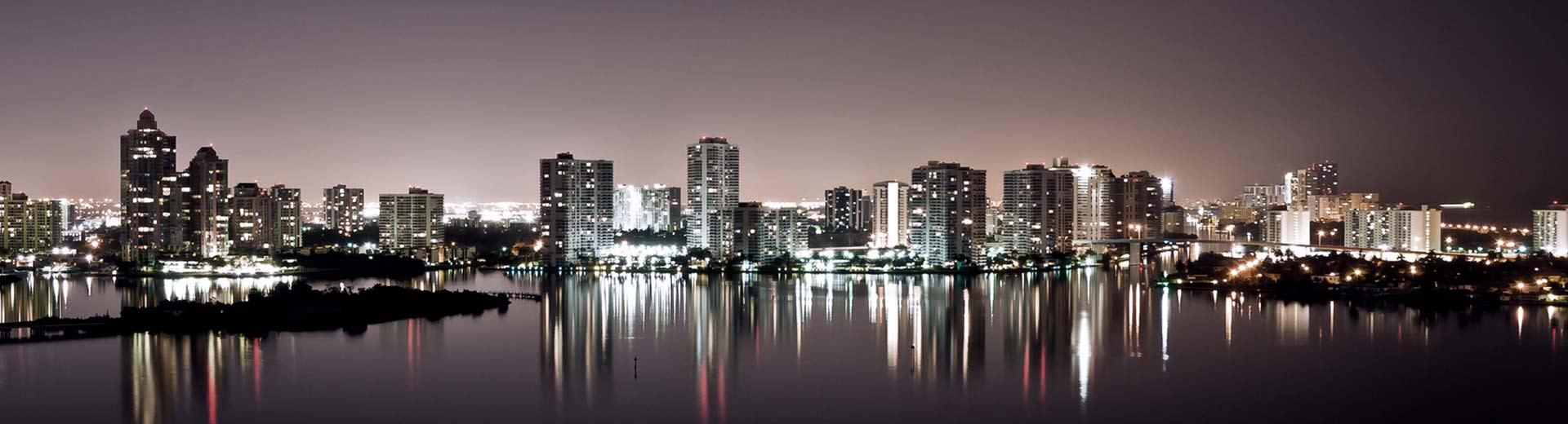 At nighttime the skyline of Fort Lauderdale lights up the sky