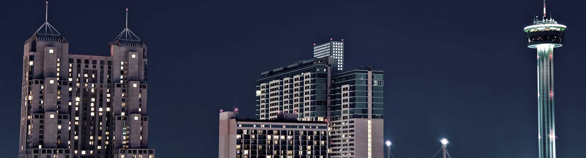 Two skyscrapers pierce the starless night sky in San Antonio