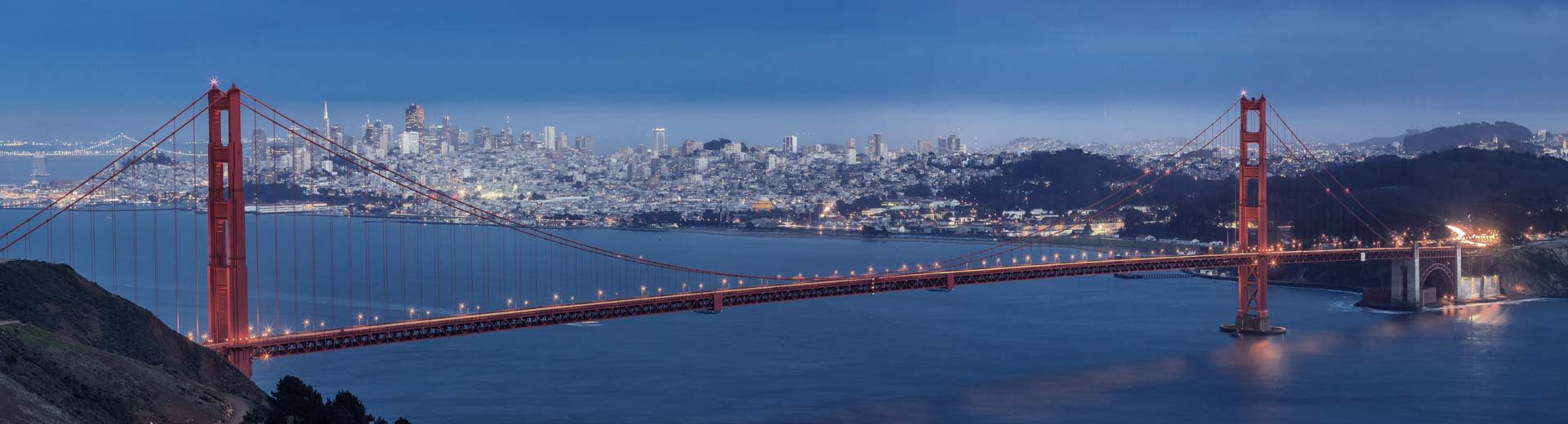 With San Francisco in the background, the world-famous Golden Gate Bridge stretches across the bay
