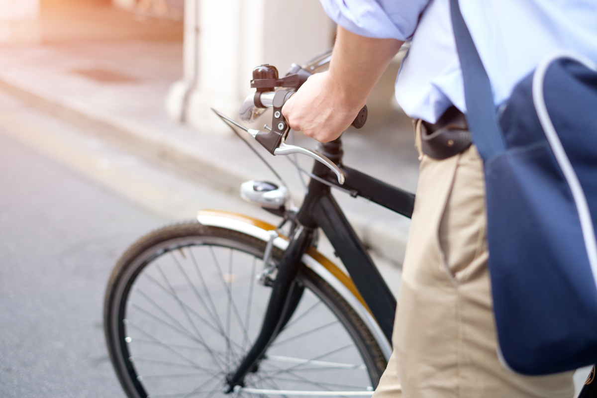 Close-up-of-man-riding-his-bike-in-the-street-609692368.jpeg