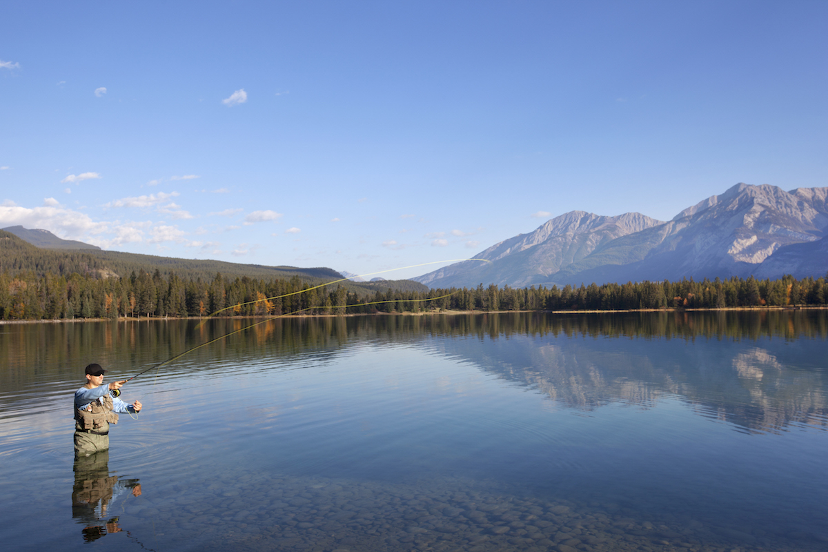 Fly-Fishing-In-Rocky-Mountains-Alberta-Canada-153216959.jpeg
