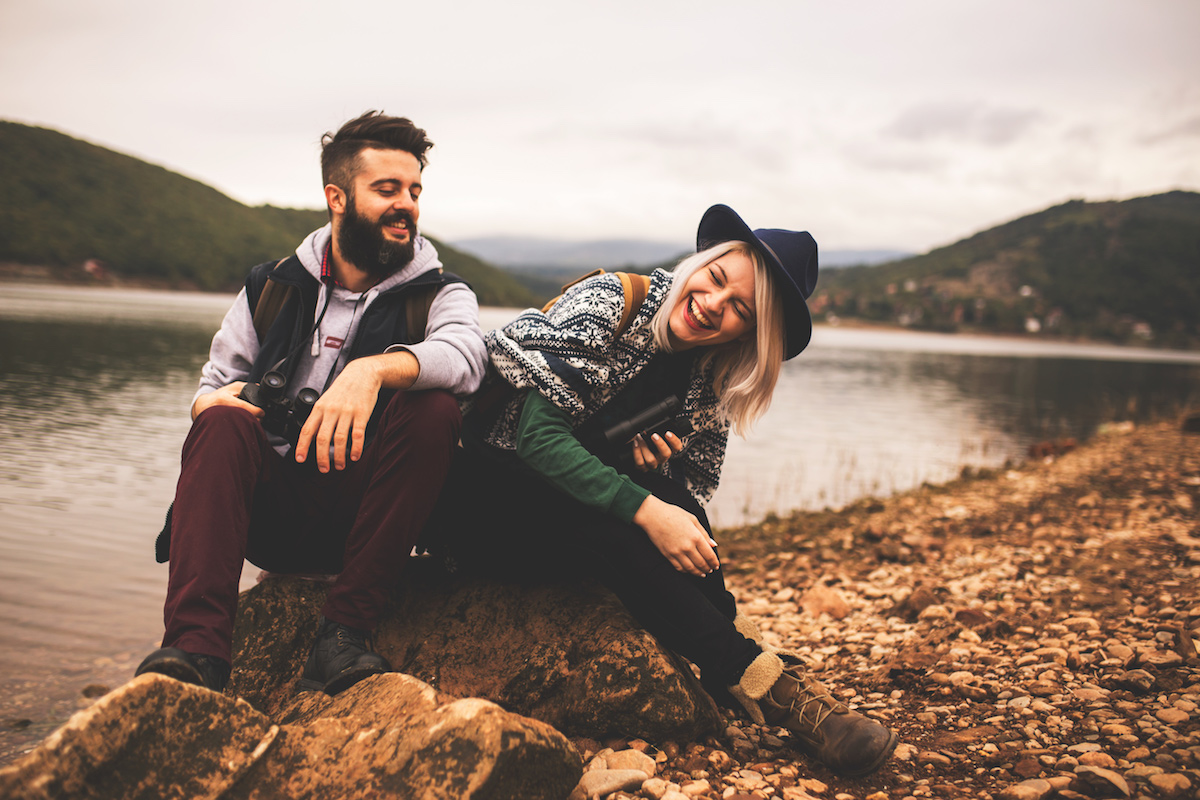 Young-smiling-couple-enjoying-nature-and-their-hiking-together-492074746.jpeg