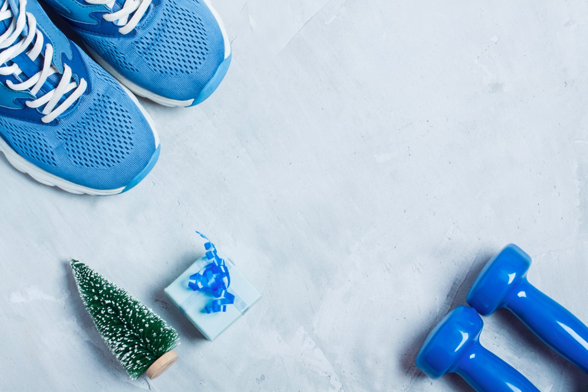 christmas-sport-composition-with-shoes-dumbbells-and-blue-gift-box-picture-id624719338-2.jpg