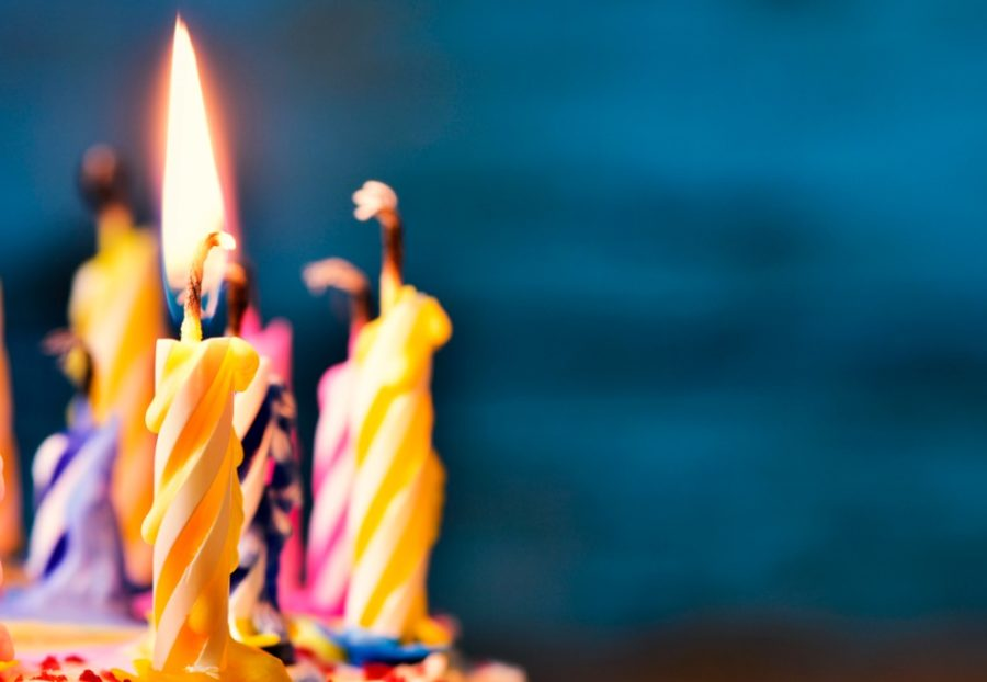 blowing-out-the-candles-of-a-cake-picture-id528061102-900x622