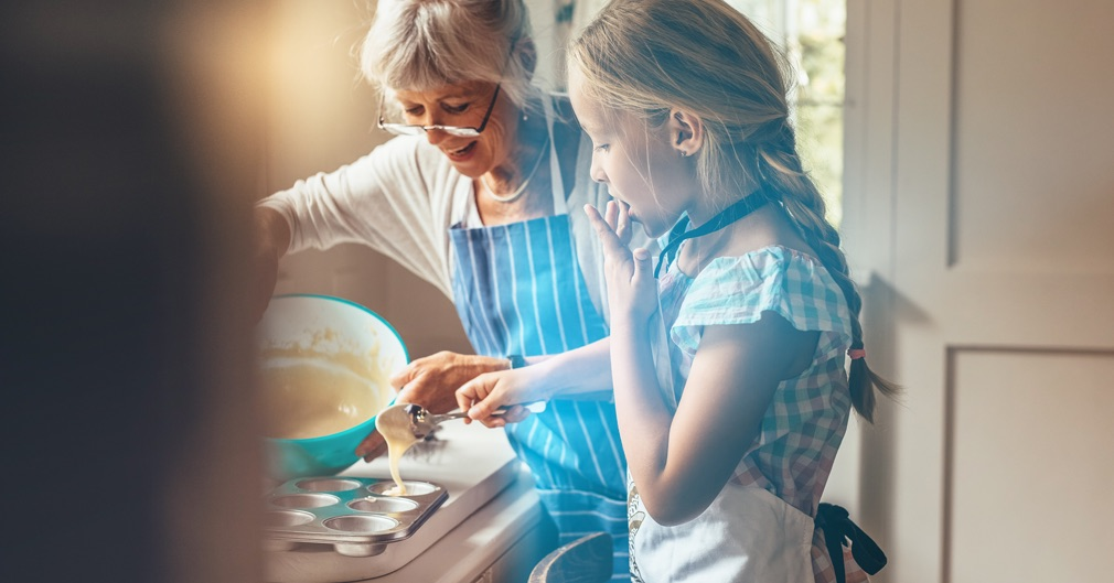 Women and Granddaughter Cooking