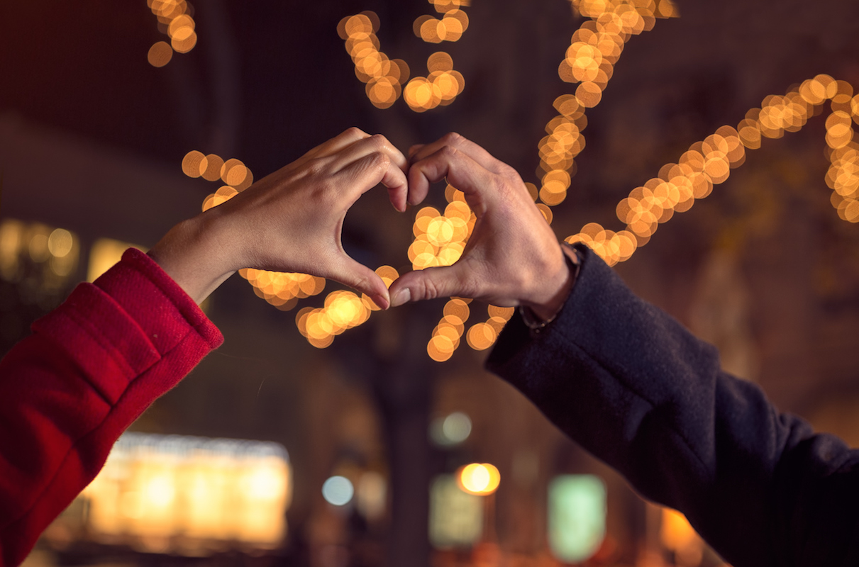 couple-making-heart-shape-with-hands-498709188.jpeg