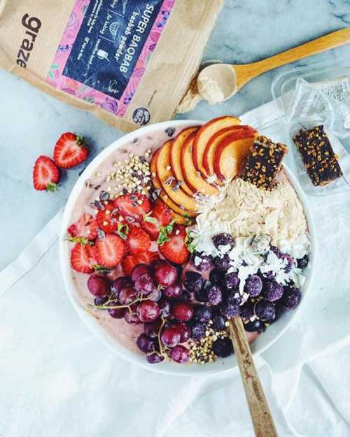 Created by @rhianamygdala​, this baobab raspberry smoothie bowl has fresh and frozen berries, peaches, grapes and our cocoa orange bites that come with a citrus-y green tea!