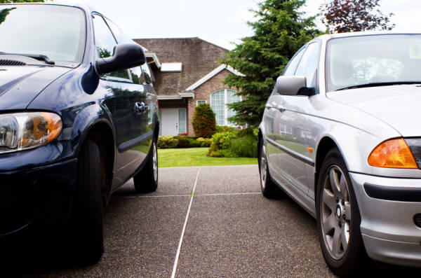 two cars parked in front of house