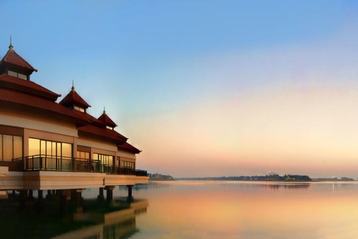 AEDXBANANT Anantara Dubai The Palm Resort Over Water Villas at Sunset