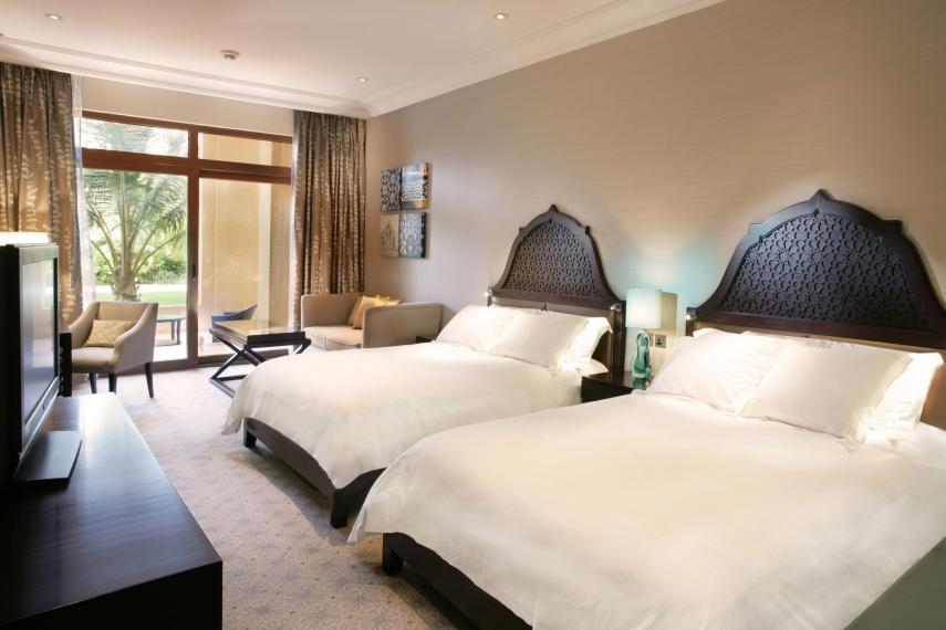 AEDXBHIRAS Hilton Resort & Spa Ras Al Khaimah Double Queen Hilton Guestroom Garden Access Bedroom