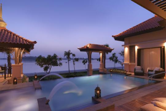 AEDXBANANT Anantara Dubai The Palm Resort Two Bed Beach Villa Pool by Night