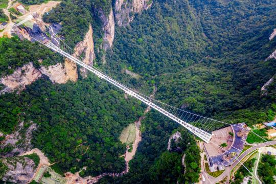 CN China Hunan China Zhangjiajie Aerial View of Glass Bottom Bridge Zhangjiajie shutterstock 1376680322