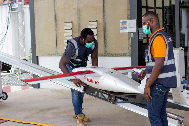 Flight operators prepping drone for departure