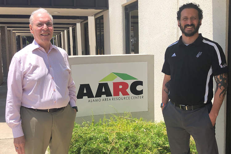 Howard Rogers  M.A., and Jacob Castrejana in front of the Alamo Area Resource Center (AARC) HIV/AIDS services agency in San Antonio.