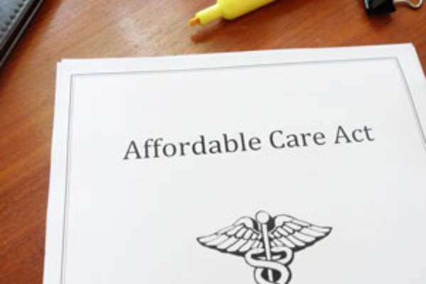 Affordable Care Act cover page on desk