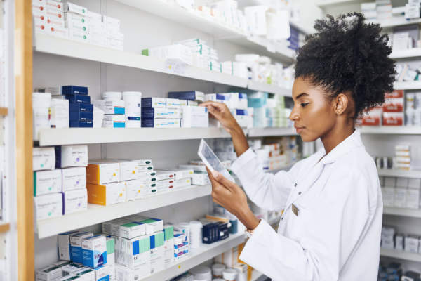 pharmacist looking at tablet