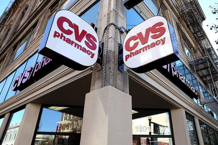 Dual CVS Pharmacy signs outside of CVS Store