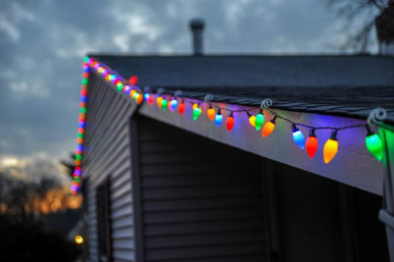 string of colorful lights on rooftop