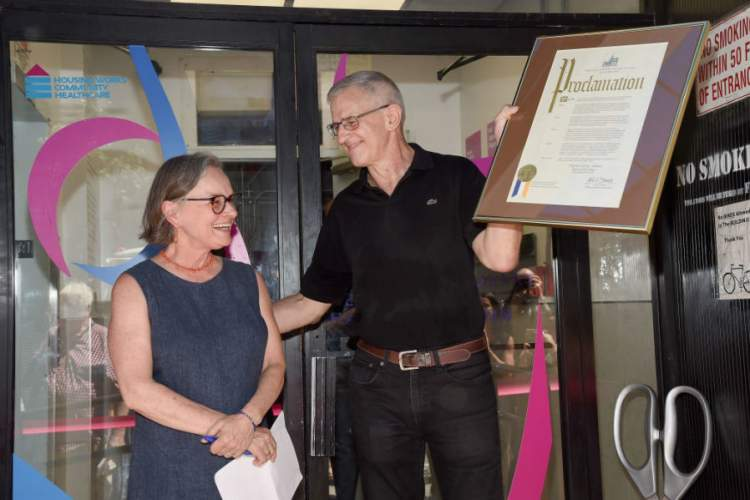 Housing Works co-founder Eric Sawyer holding a proclamation with Ginny Shubert during the dedication of The Ginny Shubert Center for Harm Reduction on July 17, 2019 in New York City.