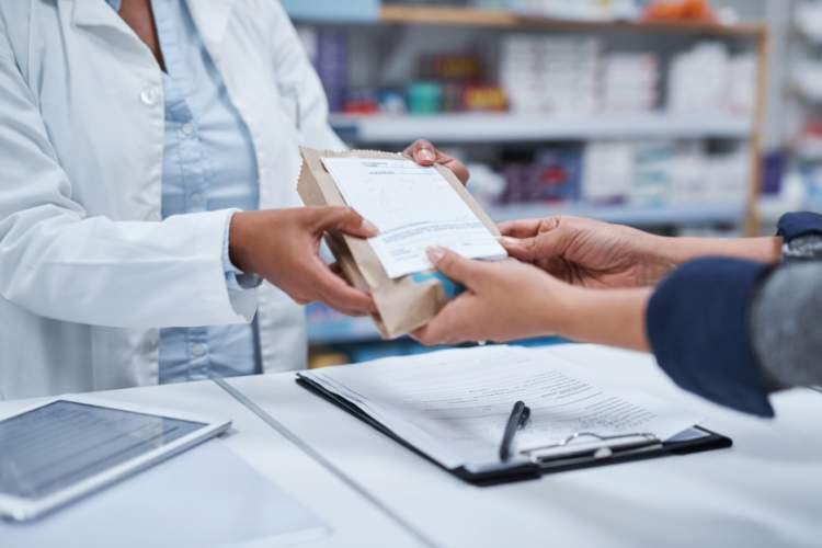 Person picking up prescription from pharmacy