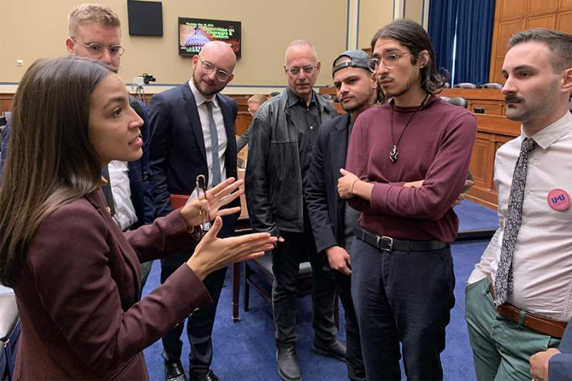 Alexandria Ocasio-Cortez speaks with members of the PrEP4All advocacy group