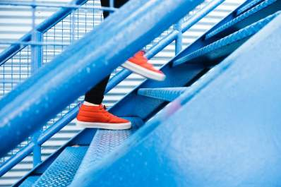 Close up of sneakers walking up stairs