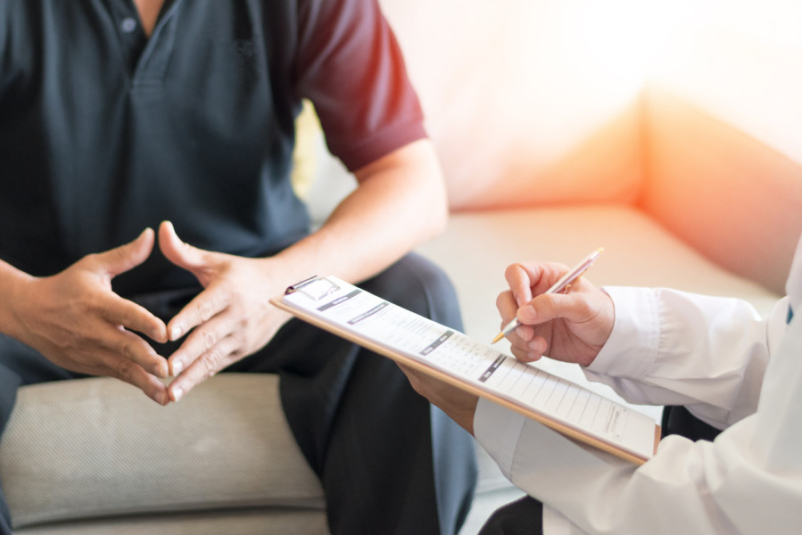 doctor looking at list talking to patient