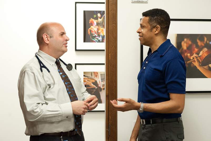 Dr. Jason Kindt (left), director of the Friedman Health Center for the Performing Arts, supported by Broadway Cares/The Actors Fund, with actor (right).