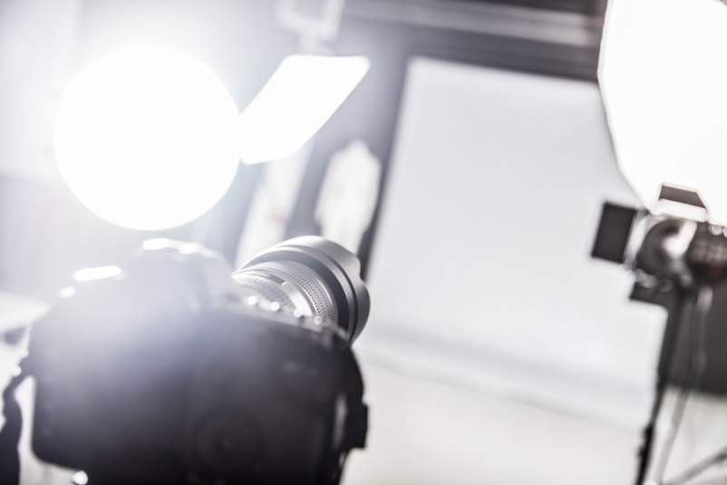 Photograpy studio with lighting equipment and a camera