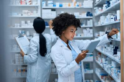 pharmacist looking at list