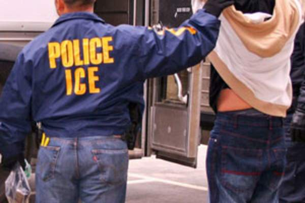 ICE officer with immigrant