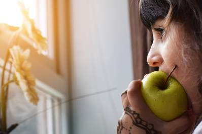 Woman biting into apple