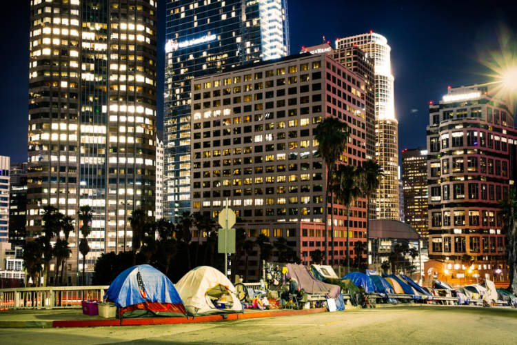 tents under downtown Los Angeles skyline